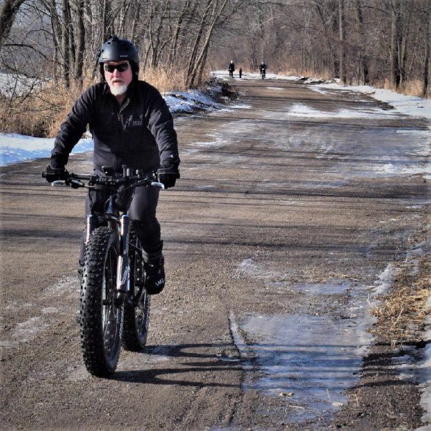 Here in today's bike pic, this bold north biker dude is having fun riding into the Monday morning sun, along the Minnesota River in Bloomington Minnesota, before the last major snow.