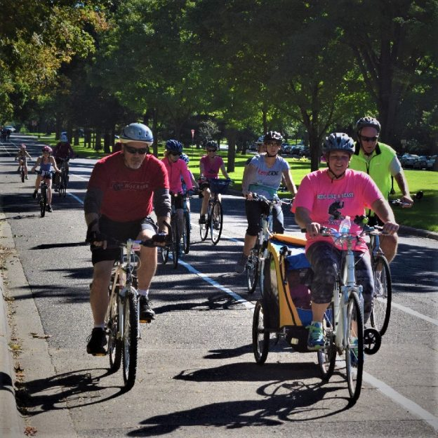 Fond summer memories riding the Saint Paul Classic Bicycle Tour, as these this group of cyclists demonstrates riding down Summit Avenue in St Paul's historic district.