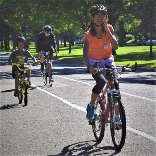 Fond summer memories riding the Saint Paul Classic Bicycle Tour, as these two young cyclists demonstrates riding down Summit Avenue in St Paul's historic district.