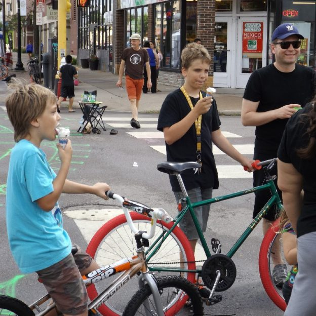Its ice cream smiles Sunday around the world and here in the united States, at an Open Streets Minneapolis these young biker dudes are enjoying a cool treat