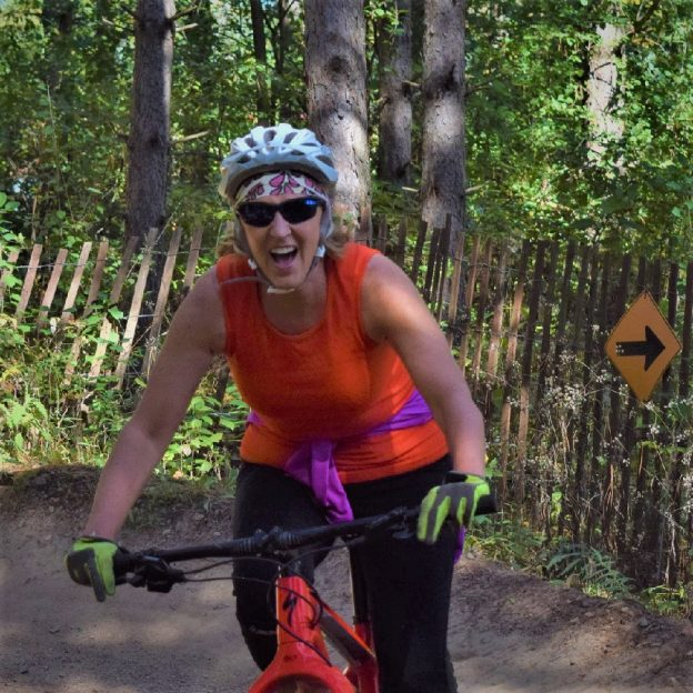 Fond summer memories with spring weather only a few days away. Here in this pic a biker chick, last season, was enjoying some time on one of Minnesota's trails.