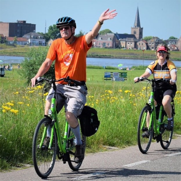 Fond summer memories riding the canals and river in the Netherlands as these cyclist demonstrates enjoying a bike and barge tour from Amsterdam to Bruges.