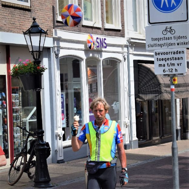 Its ice cream smiles Sunday around the world and here in the Netherlands and this cyclists is enjoying a cool treat before continuing his ride along the canals from Amsterdam to Bruges.