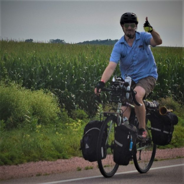 It's Friday and time think about getting together and planning some rides for the warmer months ahead. Here in this photo, last year, we caught this touring biker dude riding across Minnesota, west of Albert Lea, having fun.