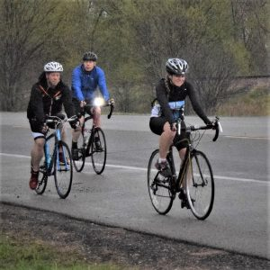 Yeah its Friday the 13th of #30 Days of biking and these cyclists just squeeze another ride before the weekend storm predicted. Here in this photo we caught this biker chick and dudes pedaling the country roads in Washington County of Minnesota.