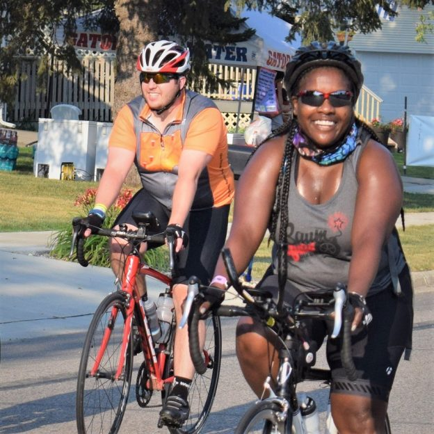 Riding into the Monday morning sun as we continue to warm up on #23 of 30 Days of Biking. Today's photo was taken on RAGBRAi and shows a biker chick having a great time along the route. What a fun way to bike across Iowa!