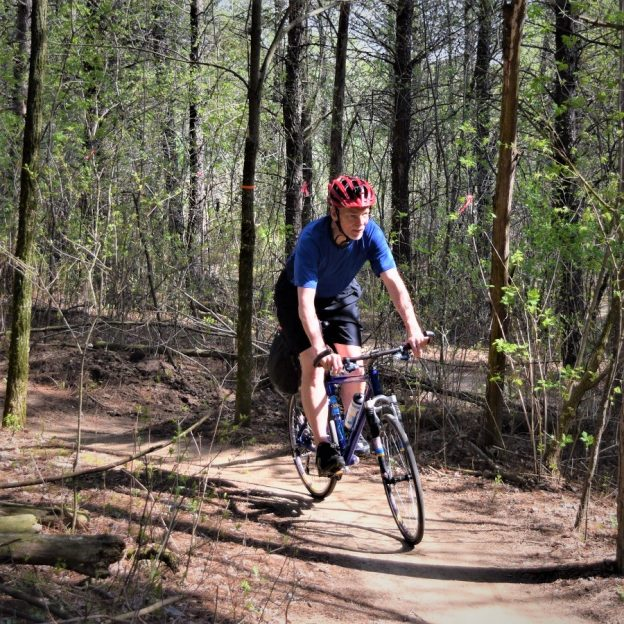 Fond spring bike pic memories on #10 of 30 Day of Biking in April. In this photo, here is what the trail should look like here in the upper Midwest. In this pic we caught this biker dude enjoying some time testing his riding skills in Lebanon Hills Park in Eagan, MN.
