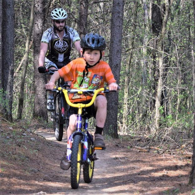 Fond early summer memories riding the mountain bike trail. Here in today pic we caught this father/son duo enjoying some time together while testing their riding skills in Lebanon Hills Park
