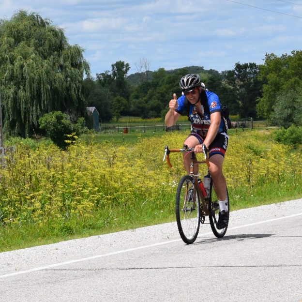 Here in today's bike pic we dig back to a previous RAGBRAi and show this biker dude, riding into the Monday morning sun, enjoying his time biking across Iowa.