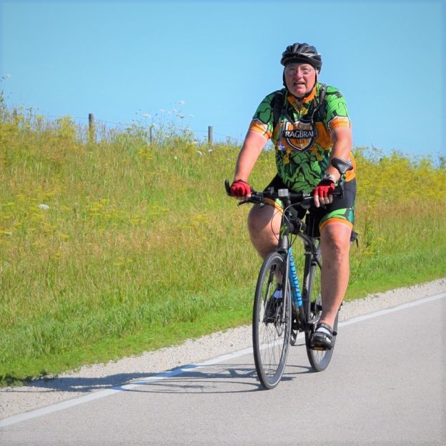 It looks like another fine spring day to ride. Here in this photo we caught this biker dude pedaling the country roads in Minnesota's bluff country, training for RAGBRAI.