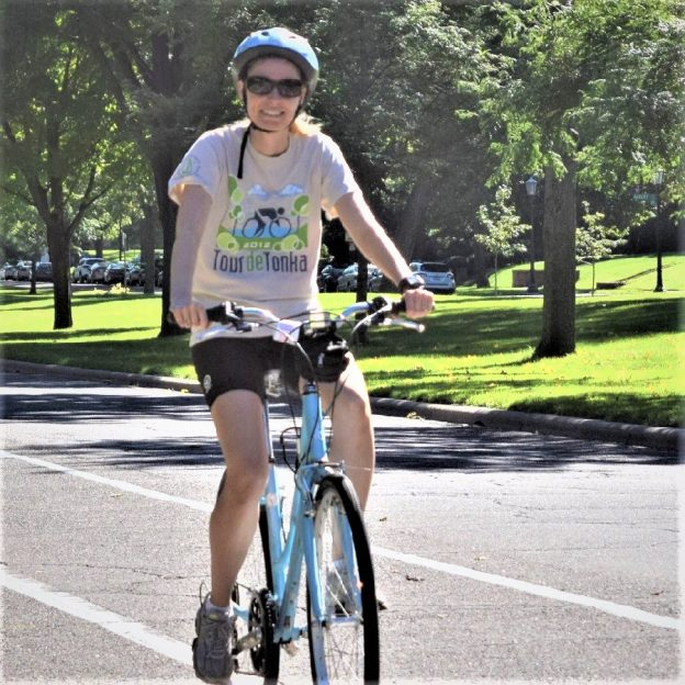 Riding into the Tuesday morning sun as we continue to warm up on #24 of 30 Days of Biking. Today's photo was taken of a biker chick having a great time along a Twin Cities route preparing for an upcoming ride you can find new HaveFunBiking Guide.