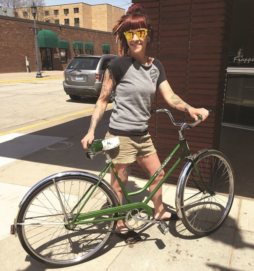 Emily lives just a couple of miles away from work and could easily drive or walk, but biking is best.
