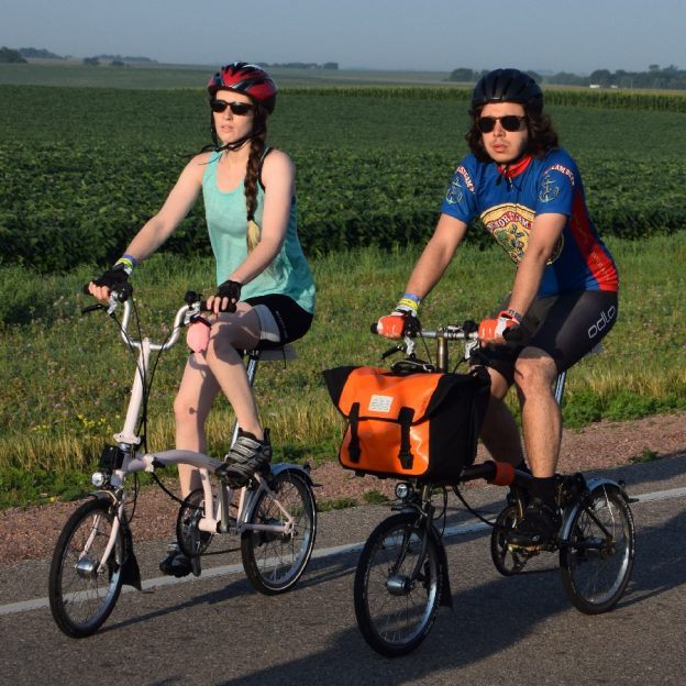 Riding into the morning sun as our spring weather, feels more like June temperatures. Today's photo was taken on RAGBRAi and shows a biker chick and dude having a great time along the route. What a fun way to see Iowa!