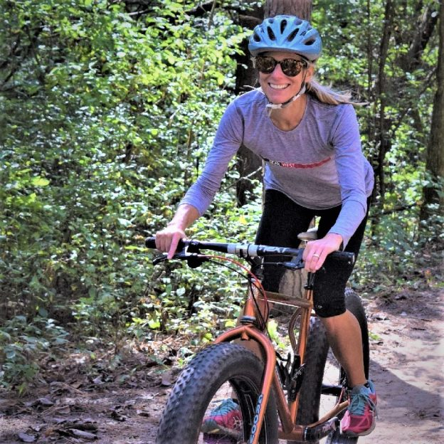 Riding into the Monday morning sun as our spring weather, feels more like June temperatures. Today's photo was taken on a Lebanon Hills Trail, in Eagan, MN with this biker chick having a great time. What a fun way to start the week!