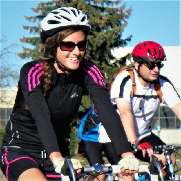Riding into the Monday morning sun as our beautiful  spring weather continues. Today's photo was taken in Lakeville, MN as this biker chick was having a great time with a friend pedaling the town.