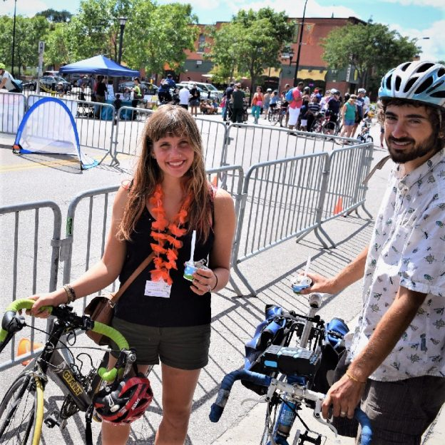 Its Ice Cream Smiles Sunday around the world. Here in Minnesota, at a Opens Street Minneapolis Event this biker chick and dude stops to smile and enjoy a creamy cool treat before resuming their bicycle ride.