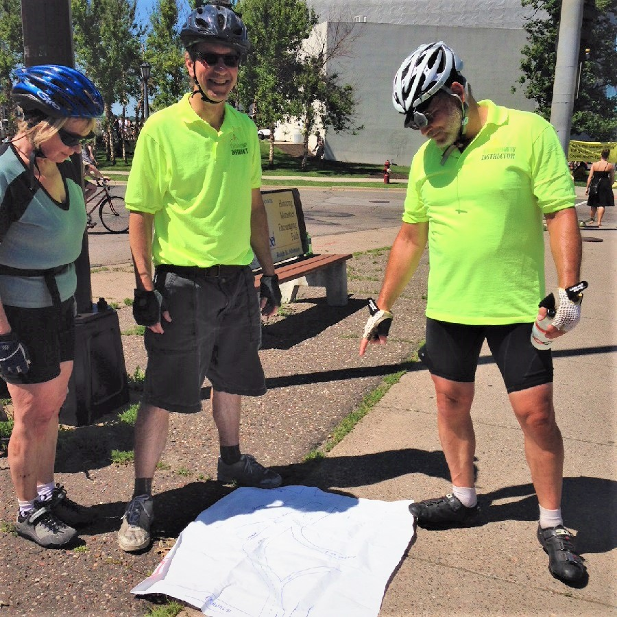 "Bike with Hokan and John Hardy doing a ""chalk talk."" Sign up for Cycling Savvy to learn more."