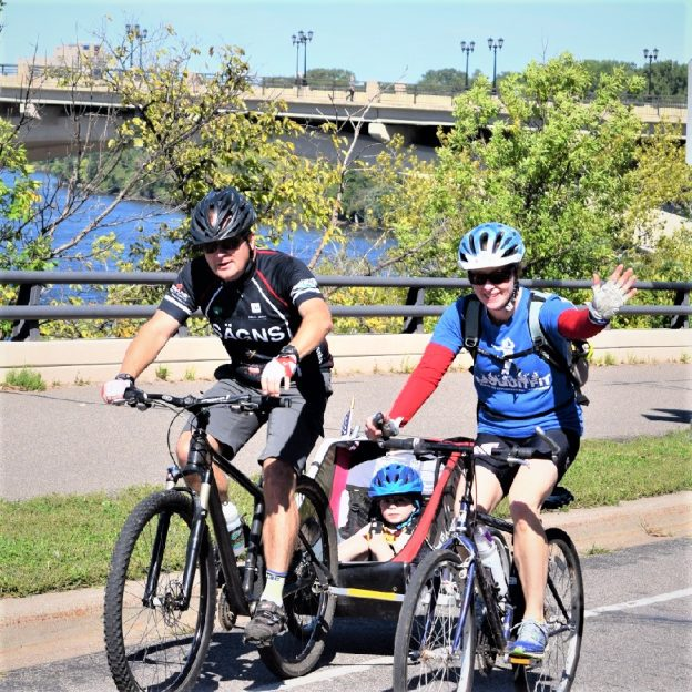 Here is today's bike pic on this beautiful Friday, with this biker dude pulling a Burly on a family outing riding in St Paul, Minnesota. along the Mississippi River Trail.