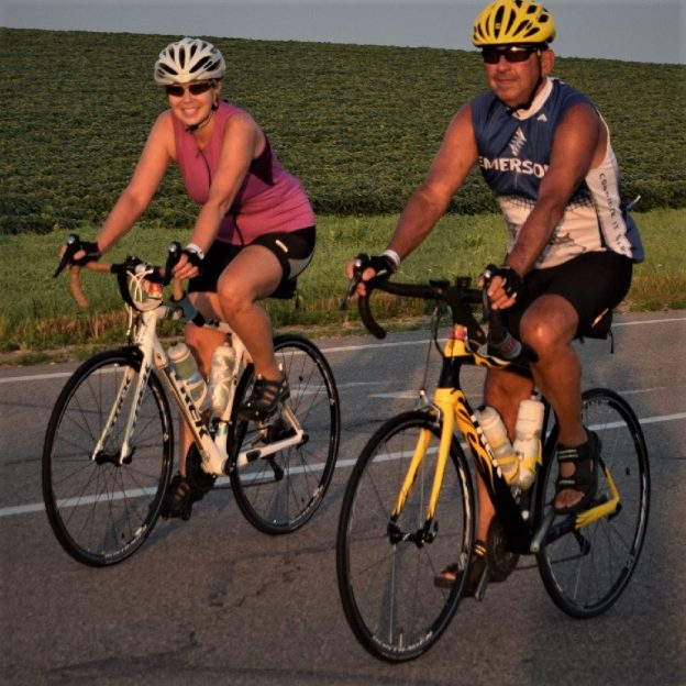 Riding into the Monday morning sun as our beautiful  spring weather continues. This photo captured this biker chick and dude riding across Iowa on RAGBRAI 2017.