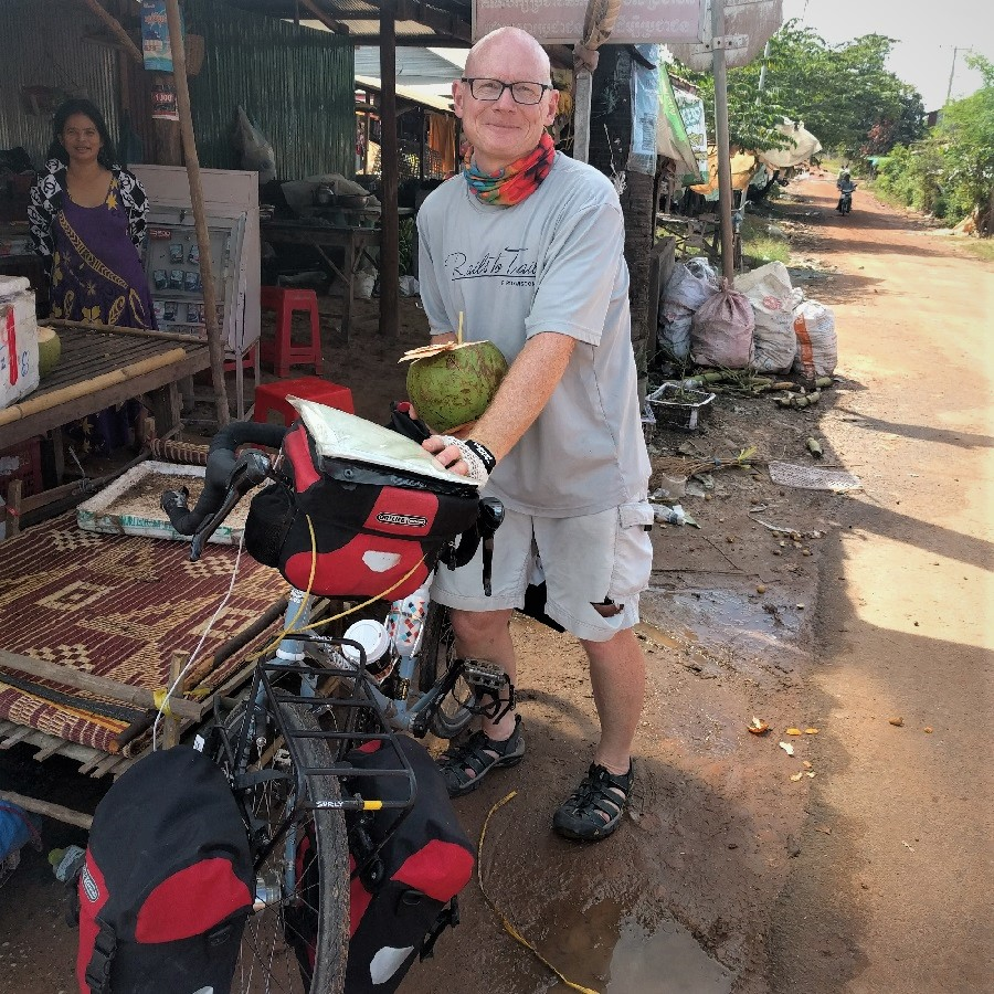 Coconut break at rural Cambodian market