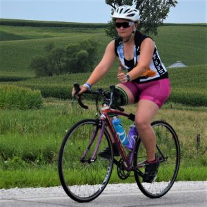 n this bike pic, we caught this biker chick pedaling her bicycle down the road into the Thursday morning sun. This picture was captured a couple weeks ago on RAGBRAI 2018.
