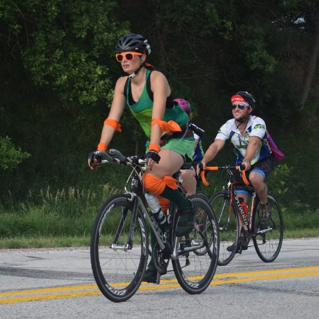 Here in this bike pic we captured another a biker chick and dude having fun pedaling into the morning sun.