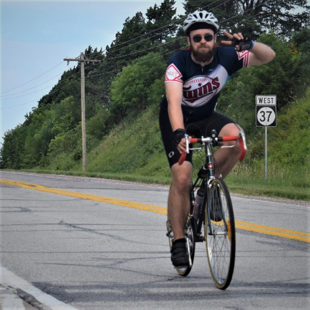 This Bike Pic Friday we are showing you another biker dude, proudly wearing his Minnesota Twinsuniform, riding across Iowa several weeks ago. Along the way, it seems everyone had a good time. See more photos atRAGBRAI 2018.