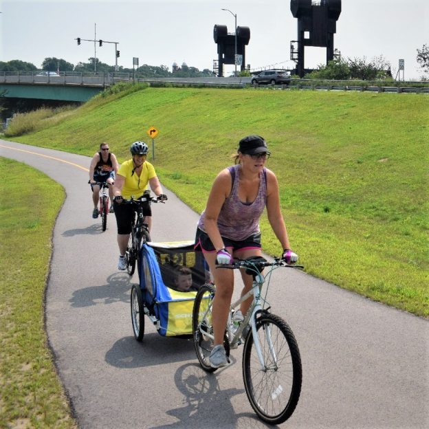 Here in this Tuesday's bike pic is a family having fun riding on the Mississippi River Trail, Just before Prescott  WI, on the westside of the St Croix River Bridge.