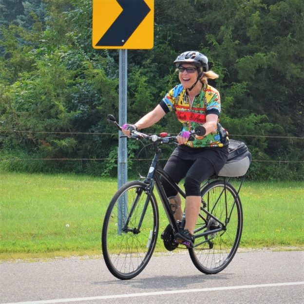 In this Thursday bike pic we caught this biker chick having fun riding on the Mississippi River Trail, west of Hastings, MN towards Pine Bend.