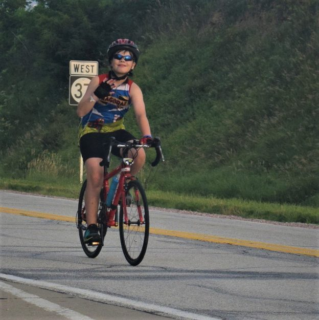 Here in this bike pic we captured another a young biker dude having fun pedaling into the morning sun on a picture perfect day riding on RAGBRAI 2018.
