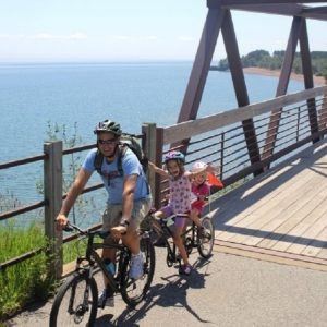 Riders on the18th Annual Gitchi-Gami Trail Association North Shore Bike Ride, August 18, will enjoy shoreline views of Lake Superior as they pass through a state park or riding over a serenading waterfall as it cascades into the lake.