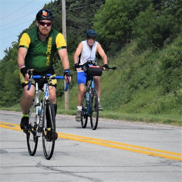 Here in this bike pic, we captured this biker dude, with a green jersey on, having fun pedaling into the Thursday morning sun, riding across Iowa.