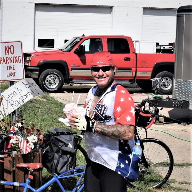 On this bike pic Sunday, this biker dude is in heaven carrying two dishes of his sweet treat choices for him and a friend. This picture was shot on this year's RAGBRAI  bike tour.