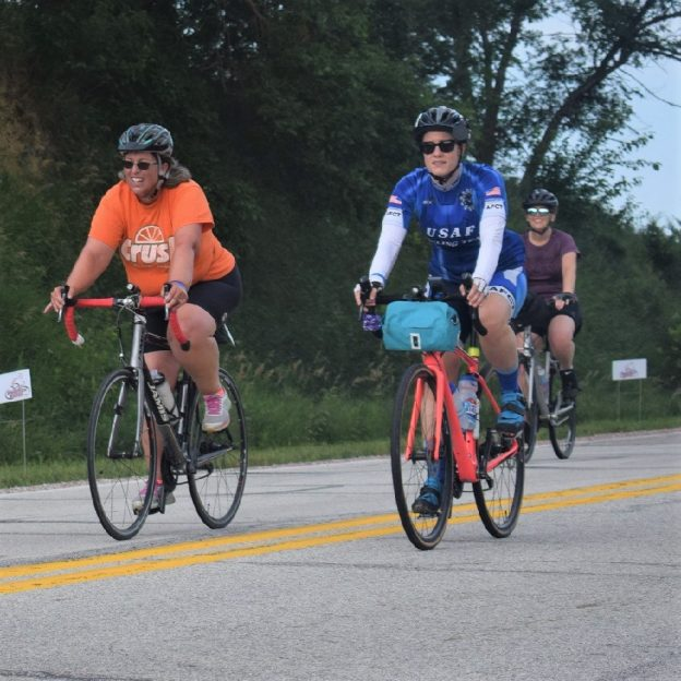Here in this bike pic we captured some biker chicks having fun pedaling into the Monday morning sun, riding across Iowa. See more fun photo on the RAGBRAI 2018 website.