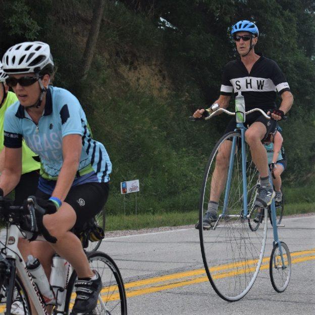 Here in this Bike Pic, we captured this biker dude on anoriginal bike wheel bike, having fun pedaling across Iowa. See more fun photo on the RAGBRAI 2018 website.