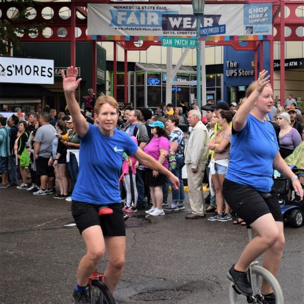 This Bike Pic Friday we are showing you a couple biker chicks, from the Twin City Unicycle Club, riding their monocycle in the daily parade at the Minnesota State Fair. With record attendance this year it looks like everyone had a good time!