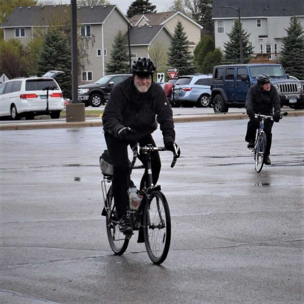Here in this bike pic Tuesday we found the cyclists riding in wet weather, though still smiling.
