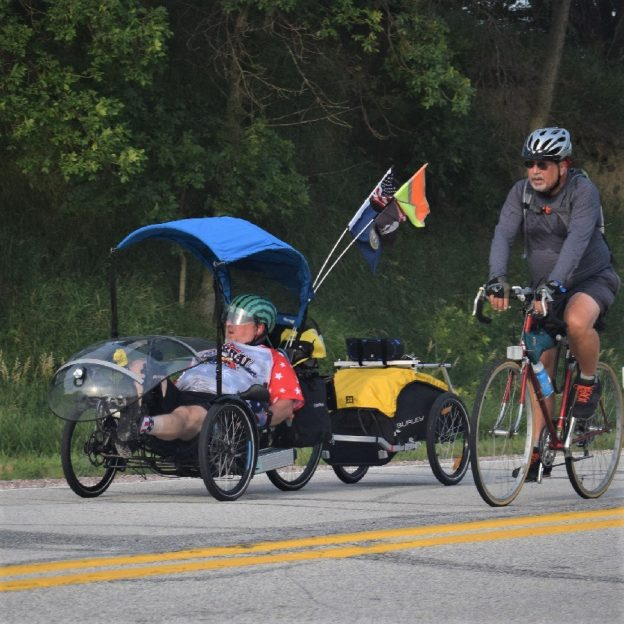 Here in this bike pic, we captured these biker dudes, one with an electric assist recumbent tricycle having fun pedaling into the Monday morning sun, riding across Iowa.