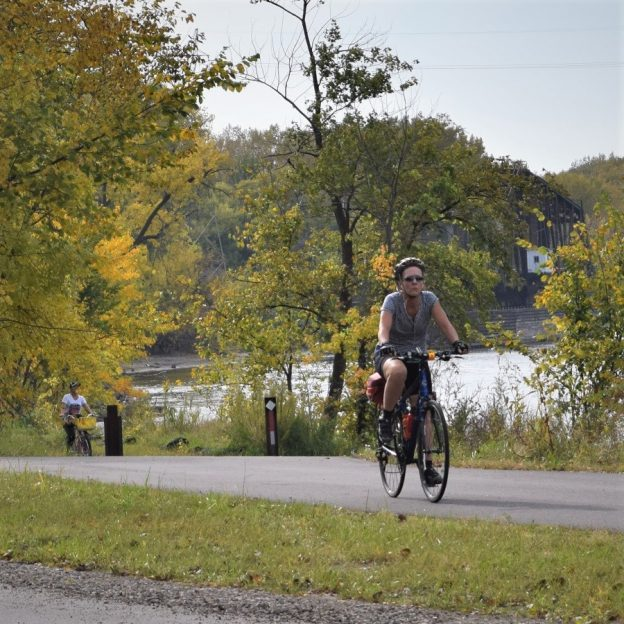 A bike pic to remember! This perfect fall weather day we caught this biker chick, pedaling along the Mississippi River Trail, on the first day of November.