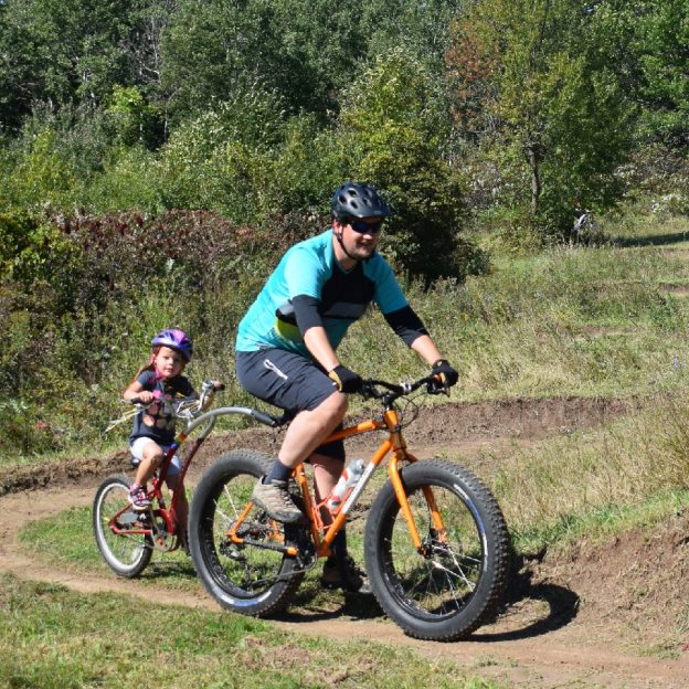 This bike pic Tuesday, enjoyyour time out riding the trails with a family member as the fall colors are at there peak. We capture this father/daughter picture in Lebanon Hills Park, home of the Wild Ride Mountain Bike Festival,September 22nd.