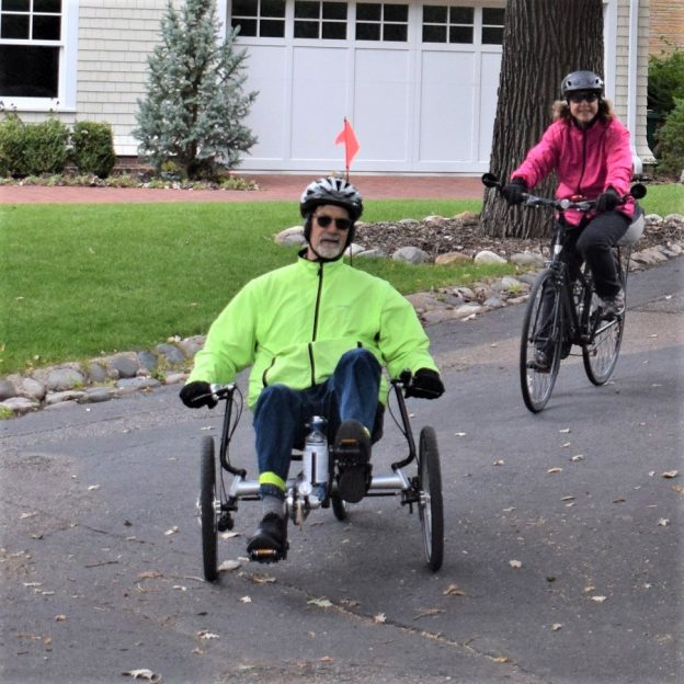 Here in this recent bike pic, we captured a biker dude on a recumbent bike, and a biker chick following behind having fun pedaling into the Monday morning sun on a recent history tour.