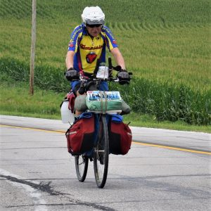 Here in this bike pic Monday, looking through the summer archive, we captured this bike dude, from Wyoming, riding into the morning sun while pedaling across Iowa. See more fun photo on the RAGBRAI 2018 website.