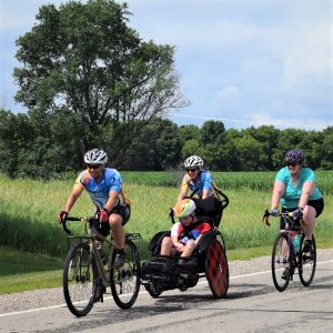 Here in this bike pic, digging through our summer archives, we captured this fun photo of a family enjoying time together on Rock-n-Roll the Lakes ride last summer in Albert Lea, MN.