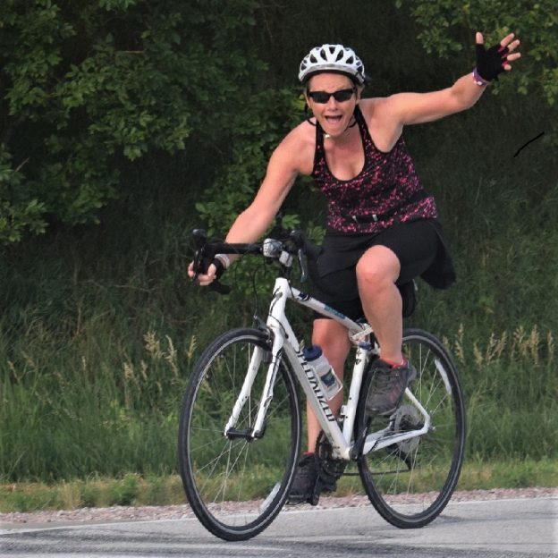 This Bike Pic Friday, digging through the summer archives we found this biker chick enjoying the Iowa countryside ready for some fun in the next town, on the ride across Iowa, RAGBRAI.
