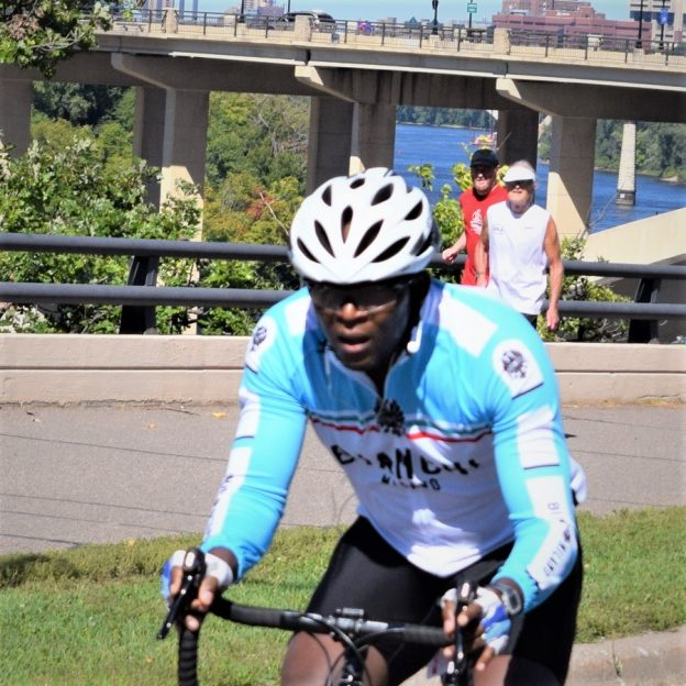 Here in this bike pic, digging through our summer archives,we captured this biker dude pedaling along the East River Road or Mississippi River Trail on the Saint Paul Bicycle Classiccourse this fall.