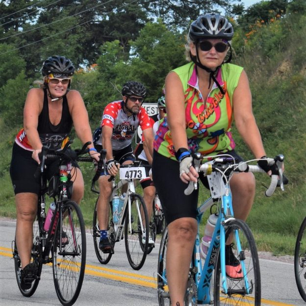 Here in this Thursday bike pic, looking through the summer archive, we captured these biker chicks riding across Iowa.