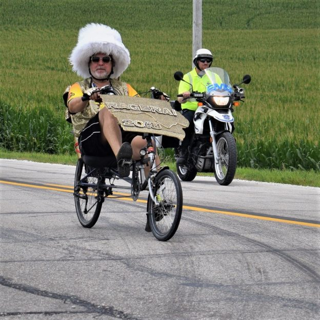 Here in this Saturday bike pic, looking through the summer archive, we captured this biker dude riding across Iowa, with a funky-fury hat.