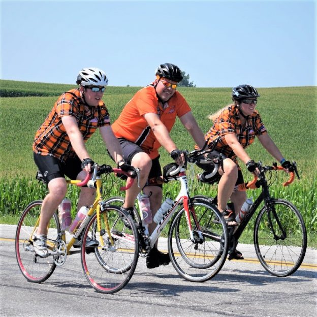 Here in this Saturday bike pic, looking through the summer archive, we captured this orange-attiredtrio riding across Iowa.