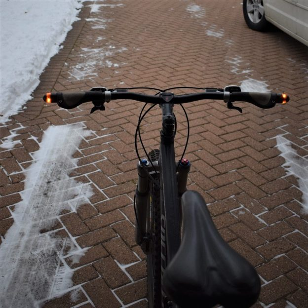 WingLights is an inexpensive blinker light system for bicycles to display a very visible directional turn signal at an intersections.