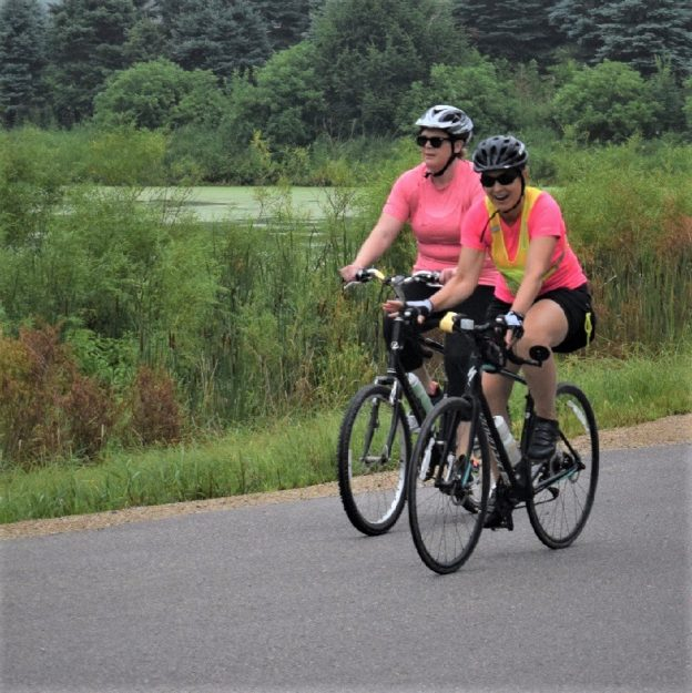Here in this Monday's bike pic, looking through the archive, we captured these biker chicks riding into the morning sun while pedaling along the southern Minnesotacountryside near Albert Lea.